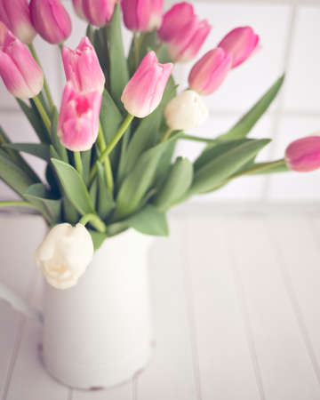bouquet fleur: Pink and white tulips in a vintage white tin jar