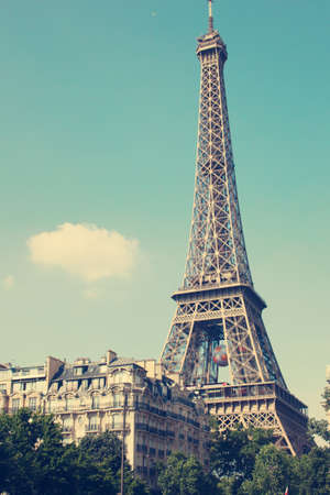 parisian: Vintage Eiffel Tower over blue sky Stock Photo