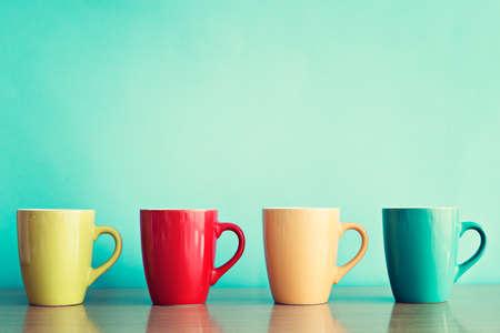 Four colorful coffee mugs