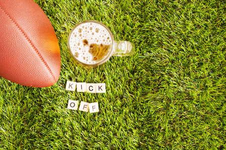 tarro cerveza: Vintage football and beer jar over grass with Kick Off message in tiles Foto de archivo