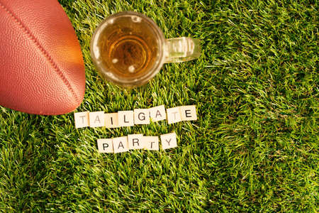 Vintage football and beer jar with Tailgate Party message