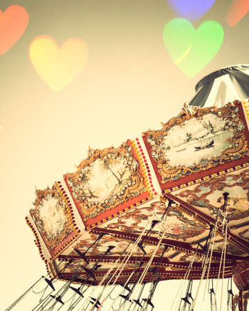 chain swing ride: Vintage chain swing ride with heart bokeh overlay Stock Photo