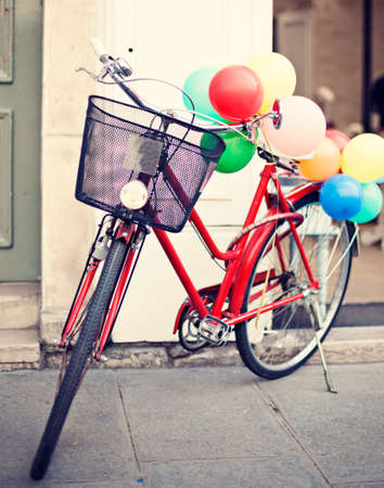 Vintage red bicycle with balloons Banco de Imagens