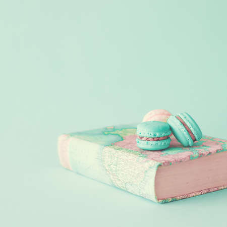 Pastel macarons over book