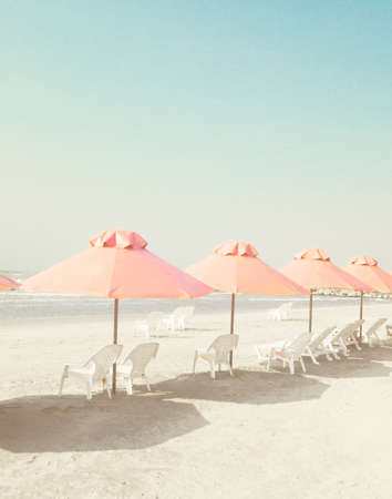 Vintage summer beach with parasols