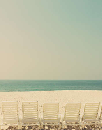 Vintage summer beach with chairs