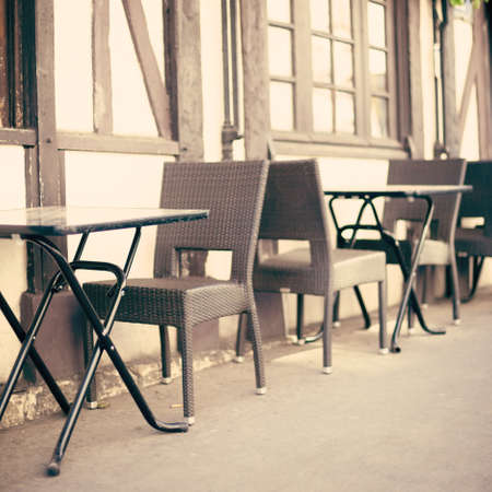 Chairs and tables of an outdoors cafe in Paris