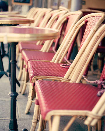 Chairs and tables of an outdoors cafe in Paris Banco de Imagens - 81165185