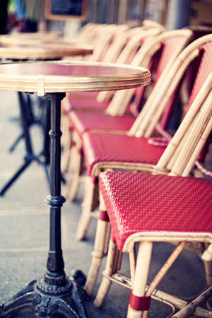 Outdoors chairs and tables of a cafe in Paris Banco de Imagens - 81165209