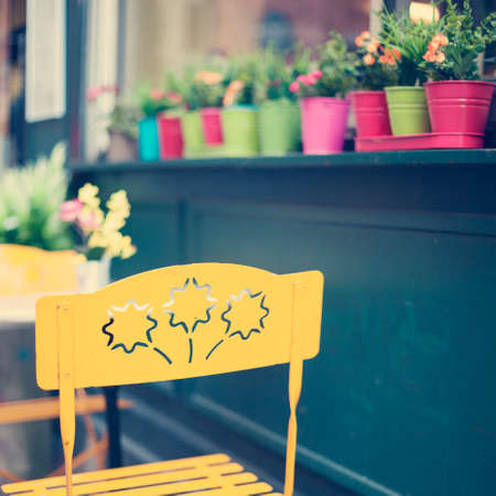 Outdoors chairs and tables of a cafe in Paris Banco de Imagens - 81165213