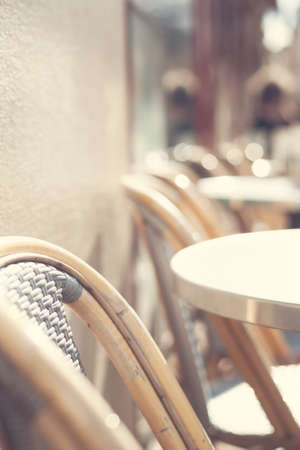 Outdoors chairs and tables of a cafe in Paris Banco de Imagens - 81165216