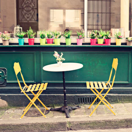 Outdoors chairs and tables of a cafe in Paris Banco de Imagens - 81165217