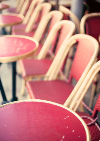 Outdoors chairs and tables of a cafe in Paris Banco de Imagens - 81165224