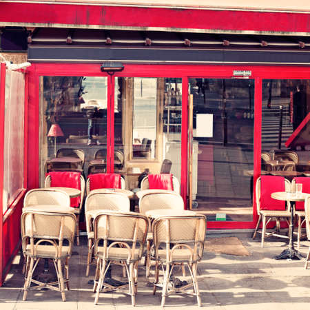 Outdoors chairs and tables of a cafe in Paris Banco de Imagens - 81165225