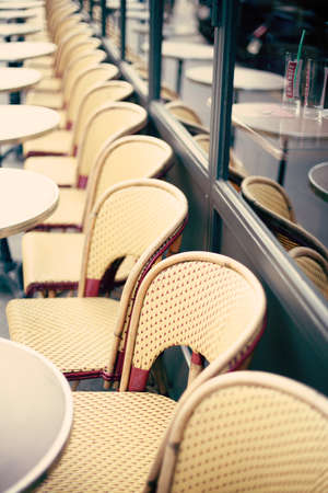 Outdoors chairs and tables of a cafe in Paris Banco de Imagens - 81165226