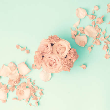 Pink roses on mint flat lay