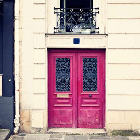 Purple door in a Parisian building Banco de Imagens