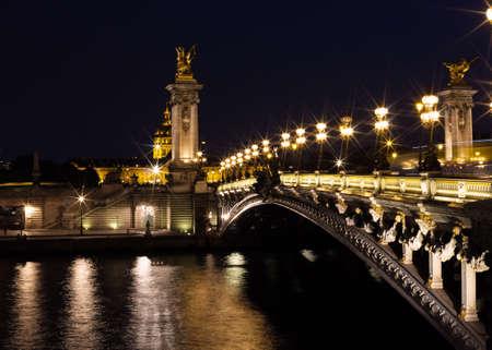Pont Alexandre III and Seine River at night Banco de Imagens