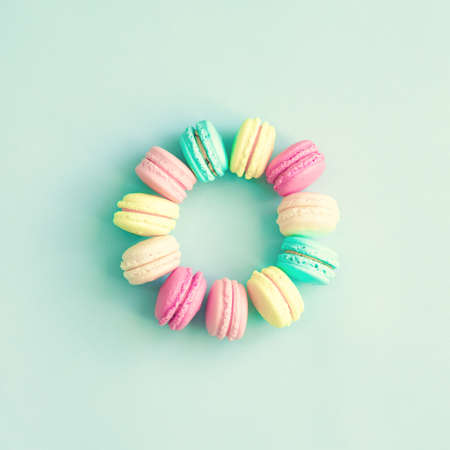 Vintage pastel french macaroons on mint