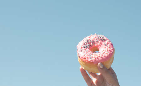 Colorful donut over deep blue sky