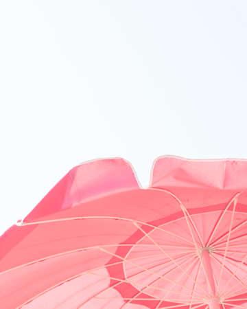 Vintage pink beach parasol Banco de Imagens