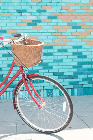Bicycle in front of a colorful wall in California