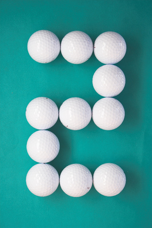 l boy: Number two writen with Golf balls