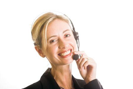 Beautiful young woman with telephone headset and lovely smile photo