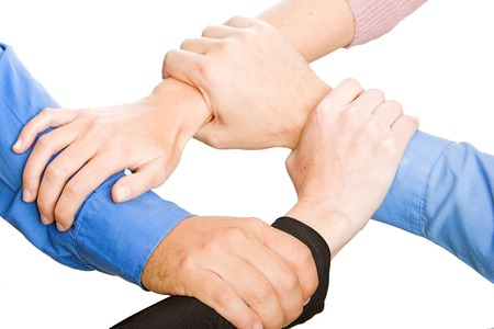 look for: team with arms together in cooperation to look for success - isolated over a white background Stock Photo
