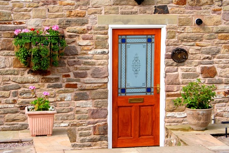 Colourfull door in sandstone wall photo