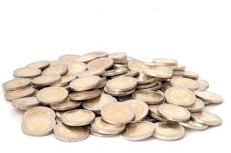 Coins are laid out abreast on a white background. Stock Photo