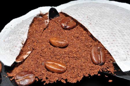 capucinno: coffee  pods on  black  background