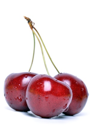 Three ripe, juicy sweet cherries on a white background.
