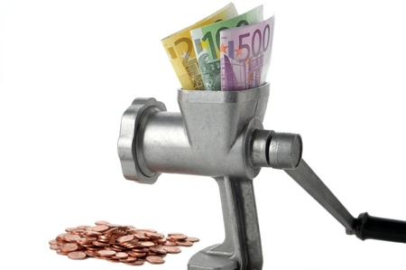 Meat grinder on a white background with money Stock Photo - 9781078