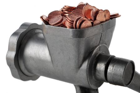 Meat grinder on a white background with coins. photo