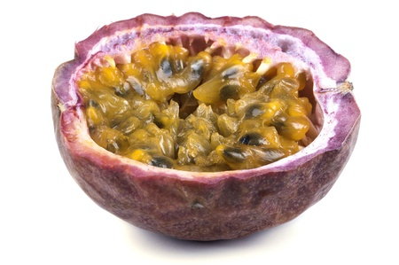 Passion fruit cut in half on a white back ground photo