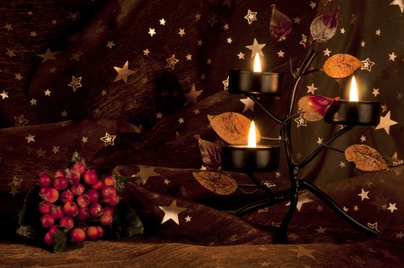 Candleholder with candles on the starry background photo