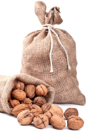Walnut in a bag on a white background Stock Photo