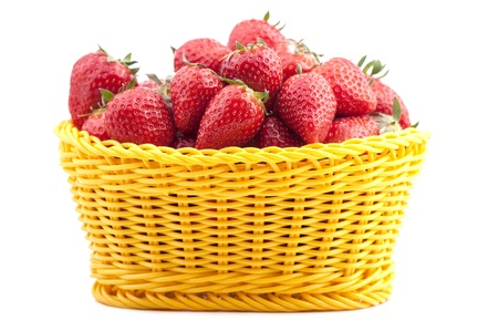 Strawberry in a basket on a white background photo