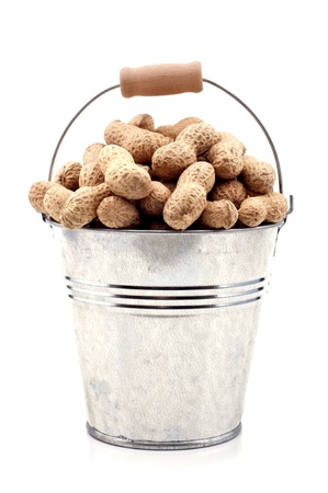 unpeeled: Peanut in a bucket on a white background