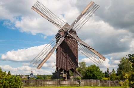 Mill in summer day against the sky Stock Photo