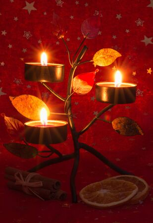 Christmas candle  on red background photo
