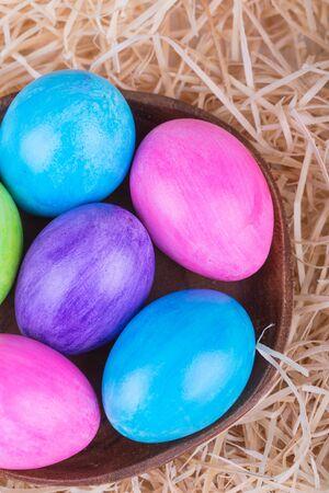 shavings: Colorful painted easter eggs in wood shavings