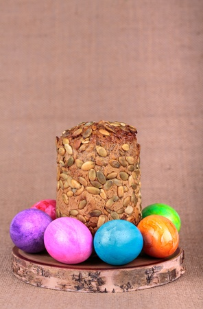 Easter eggs with bread on burlap background Stock Photo - 17894022