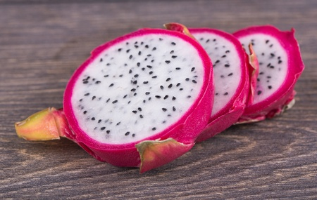 Fresh pitahaya cut on a wooden background Stock Photo - 18373320