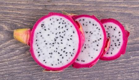 Fresh pitahaya cut on a wooden background Stock Photo - 18373308