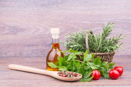 Fresh rosemary, parsley with oil on wooden  background Stock Photo - 18768718