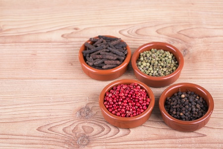 Assorted  spices in petri on wooden background photo