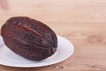 cocoa fruit on wooden background photo