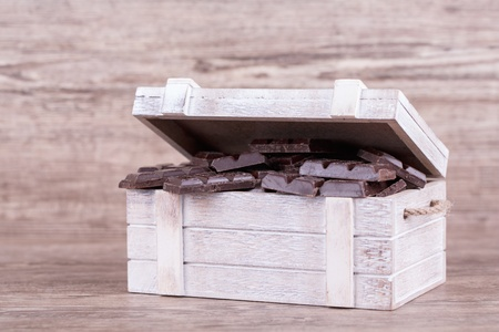 Chocolate with nuts on a wooden background Stock Photo - 19844345